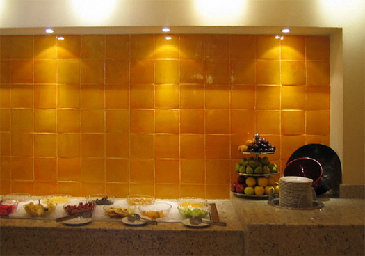 backsplash with yellow mexican tile
